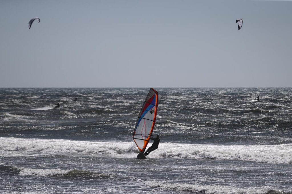 Windsurfer surfing waves at Pistol River near Gold Beach