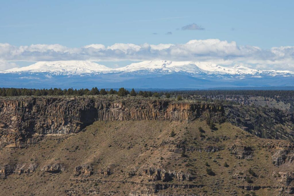 Canyon and snowcapped mountains on the Crooked River Rim Trail