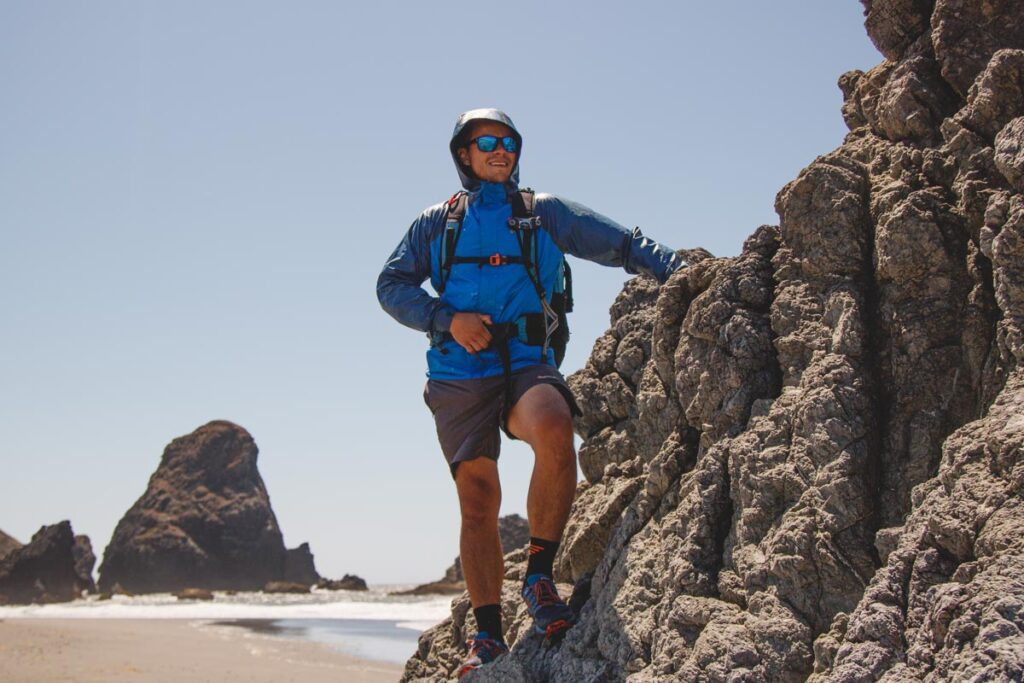 Man in hiking gear on rocks at Gold Beach