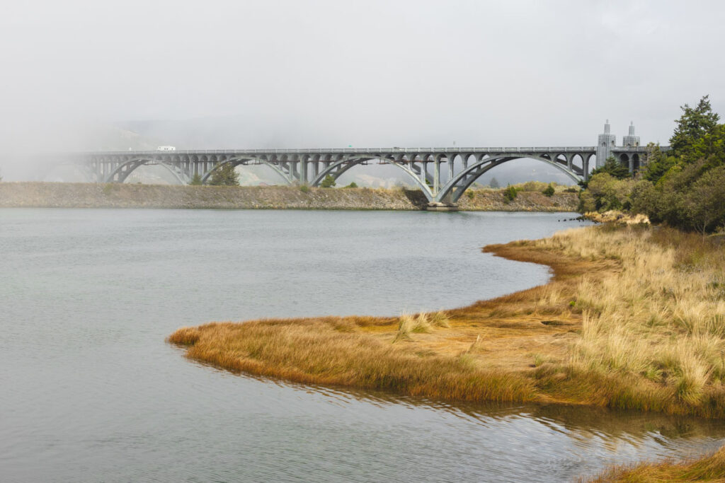Mist covering bridge over Rogue River in Gold Beach
