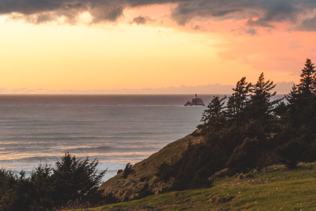 Sunset over Pacific Ocean with Tillamook Rock Lighthouse